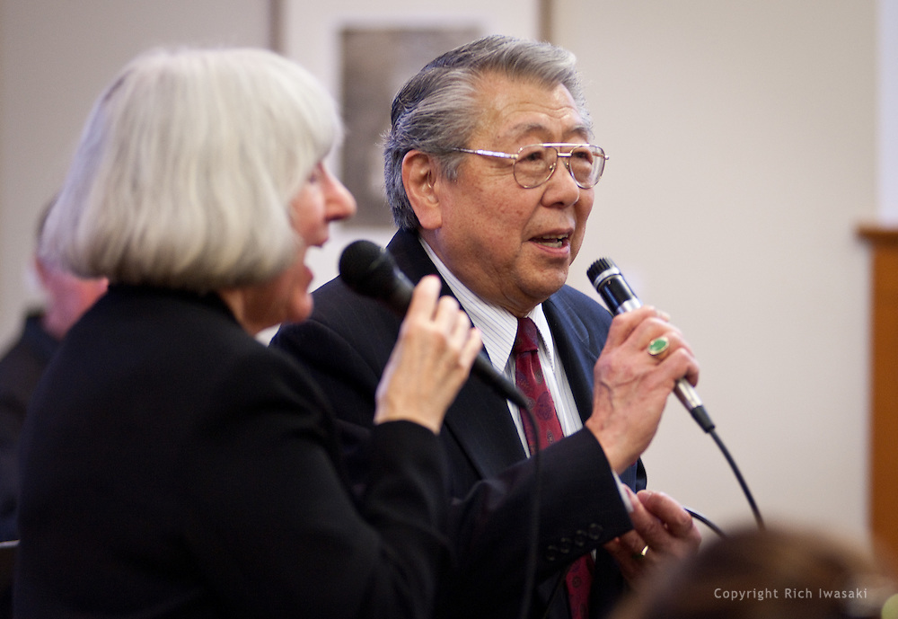 """Vocalists Jo Peterson (left) and Henry """"Shig"""" Sakamoto perform with the Minidoka Swing Band in the US Bank Room of Multnomah County Library - Central branch, Portland, Oregon. The performance was in conjunction with Portland Center Stage's production of Snow Falling on Cedars, by David Guterson."""