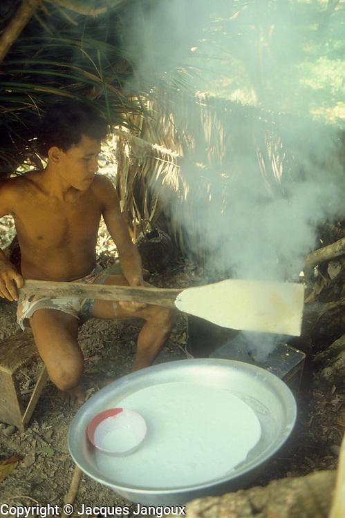 Brazil, Pará: coagulation with smoke of rubber tree latex.