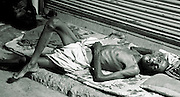 old man sleeping on footpath, delhi, india