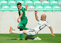 Boban Jovic #5 of Olimpija vs Josip Fucek of Krka during football match between NK Olimpija and NK Krka in Round 1 of Prva liga Telekom Slovenije 2014/15, on July 19, 2014 in SRC Stozice, Ljubljana, Slovenia. Photo by Vid Ponikvar / Sportida.com