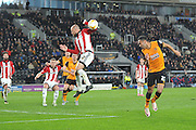 Hull City midfielder Ahmed Elmohamady (27) heads towards goal during the Sky Bet Championship match between Hull City and Brentford at the KC Stadium, Kingston upon Hull, England on 26 April 2016. Photo by Ian Lyall.
