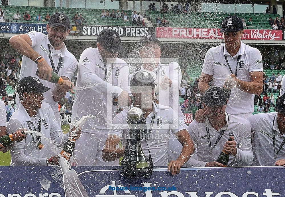 The England players (LtoR front)  Joe Root , Captain Alastair Cook, Sam Robson (Back) Ian Bell, Jimmy Anderson, Gary Ballance and Chris Woakes celebrate their easy win in the Investec Test Match match at the Kia Oval, London<br /> Picture by Alan Stanford/Focus Images Ltd +44 7915 056117<br /> 17/08/2014