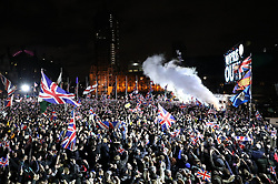 © Licensed to London News Pictures. 31/01/2020. London, UK. People celebrate at 11 o'clock in Parliament Square as the United Kingdom leaves the European Union. Photo credit: Peter Macdiarmid/LNP