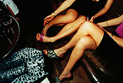 Two Women Seated in Nightclub