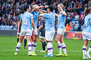 Manchester City Women forward Lee Geum-min (17) scores a goal and celebrates with team mates and Manchester City Women defender Steph Houghton (captain) (6)  to make the score 3-0 during the FA Women's Super League match between Manchester City Women and BIrmingham City Women at the Sport City Academy Stadium, Manchester, United Kingdom on 12 October 2019.
