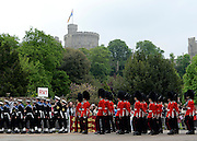 © Licensed to London News Pictures. 19/05/2012. WIndsor, UK Troops march through Windsor. Armed Forces muster and parade in Windsor today , 19th May 2012, in tribute to Her Majesty the Queen for the Diamond Jubilee. 2,500 troops paraded through the town before the Queen and Duke of Edinburgh to mark the Diamond Jubilee. Once the parade has passed the Queen and Duke traveled along the same route to an arena within Home Park, where the troops mustered. A tri-service flypast of 78 aircraft, including helicopters, Hawks, the Battle of Britain Memorial Flight, the Red Arrows and Tornados went overhead. Photo credit : Stephen Simpson/LNP