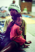The wife and son of a man killed at the hamlet of Shoboshobane at a church in Port Shepstone.  On Christmas Day, the ANC village was attacked by Inkatha neighbours killing more than 20 residents, and driving the rest into refugee camps.  December 26th, 1995.
