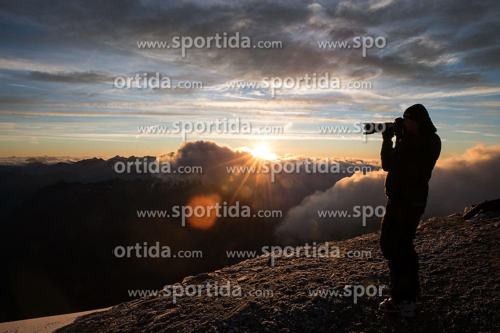 THEMENBILD - Fotograf im Gegenlicht der aufgehenden Sonne am Gipfel der Baumbachspitz (3105m), aufgenommen am 7. Oktober 2014 // Photographer in the backlight of rising sun at the top of Baumbach Spitz (3105m), Pictures on October 7, 2014. EXPA Pictures © 2014, PhotoCredit: EXPA/ Johann Groder