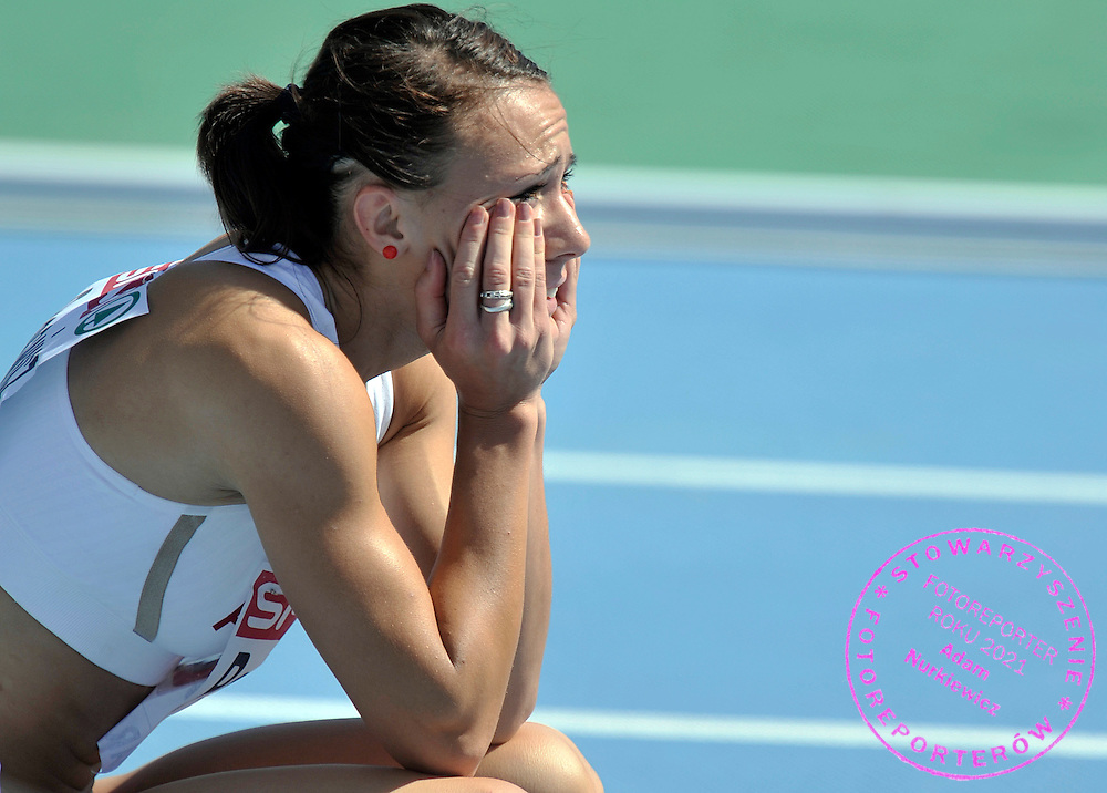 MARIKA POPOWICZ (POLAND) RESTS AFTER THE WOMEN'S 100 METERS QUALIFICATION DURING THE 2010 EUROPEAN ATHLETICS CHAMPIONSHIPS AT OLYMPIC STADIUM IN BARCELONA, SPAIN...SPAIN , BARCELONA , JULY 28, 2010..( PHOTO BY ADAM NURKIEWICZ / MEDIASPORT )..PICTURE ALSO AVAIBLE IN RAW OR TIFF FORMAT ON SPECIAL REQUEST.