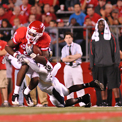 Sep 19, 2009; Piscataway, NJ, USA; Rutgers wide receiver Mohamed Sanu (6) is wrapped up by Florida International cornerback Peter Riley (39) during the second half of Rutgers' 23-15 victory over Florida International at Rutgers Stadium.