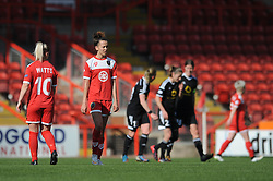 Bristol Academy's Gabbie Simmons-Bird cuts a dejected figure as FFC Frankfurt celebrate their goal - Photo mandatory by-line: Dougie Allward/JMP - Mobile: 07966 386802 - 21/03/2015 - SPORT - Football - Bristol - Ashton Gate Stadium - Bristol Academy v FFC Frankfurt - UEFA Women's Champions League - Quarter Final - First Leg