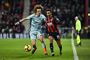 Chelsea Defender, David Luis (30) and AFC Bournemouth Midfielder, Junior Stanislas (19) challenge for the ball during the Premier League match between Bournemouth and Chelsea at the Vitality Stadium, Bournemouth, England on 30 January 2019.