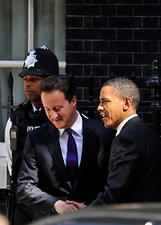 © licensed to London News Pictures. LONDON, UK  25/05/11. Barak Obama and David Cameron wave to the media as they meet in Downing Street during US President Obama's first State Visit to the United Kingdom. Please see special instructions. Photo credit should read Stephen Simpson/LNP