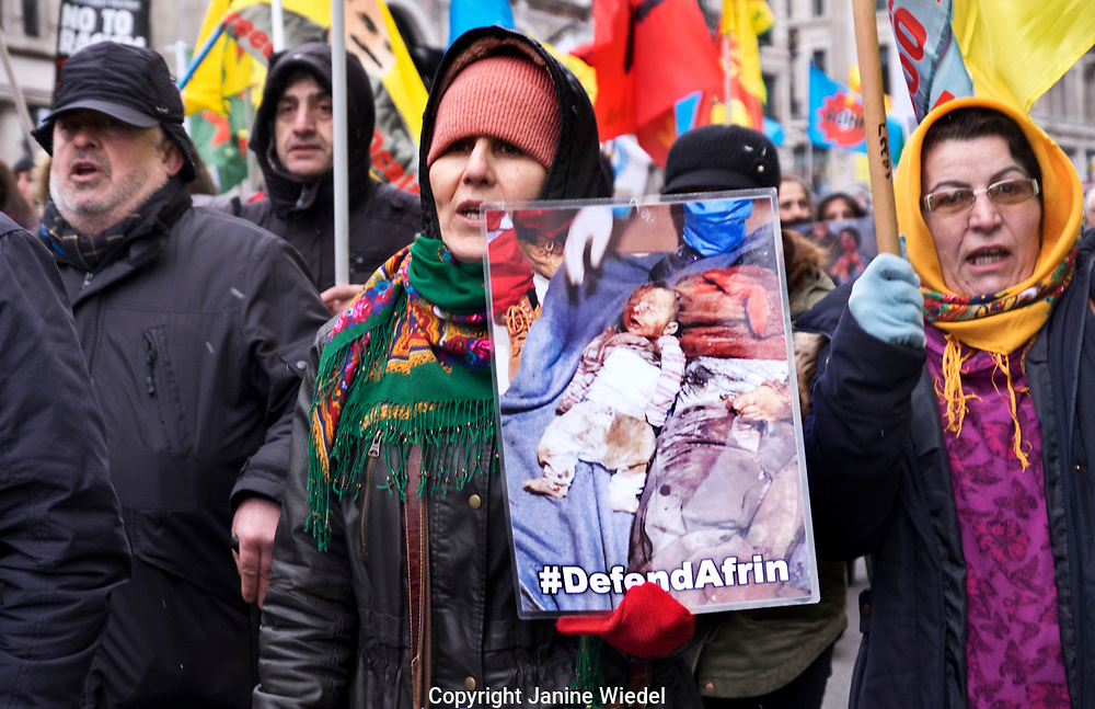Kurdish men and  women protesting genocide by Turkish troops in Afrin Syria on Stand up against Racism, International demonstration in London to mark UN anti-racism day. March 17 2018