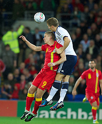 12.10.2012, Cardiff City Stadium, Cardiff, WAL, FIFA WM Qualifikation, Wales vs Schottland, im Bild Wales' Steve Morison in action against Scotland's Christophe Berra during FIFA World Cup Qualifier Match between Wales and Scotland at the Cardiff City Stadium, Cardiff, Wales on 2012/10/12. EXPA Pictures © 2012, PhotoCredit: EXPA/ Propagandaphoto/ David Rawcliffe..***** ATTENTION - OUT OF ENG, GBR, UK *****