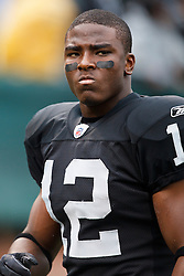 December 19, 2010; Oakland, CA, USA;  Oakland Raiders wide receiver Jacoby Ford (12) warms up before the game against the Denver Broncos at Oakland-Alameda County Coliseum.