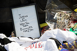 © Licensed to London News Pictures . 13/05/2016 . Liverpool , UK . Tributes left by the memorial . A memorial to the victims of the Hillsborough Disaster , cast in bronze in the shape of a 7ft drum , at the bottom of St John's Gardens , near the corner of William Brown Street , in Liverpool City Centre . The monument was commissioned by the Hillsborough Justice Campaign and created by Liverpool sculptor Tom Murphy . Photo credit : Joel Goodman/LNP