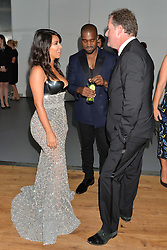 KIM KARDASHIAN, KANYE WEST and PIERS MORGAN at the GQ Men Of The Year 2014 Awards in association with Hugo Boss held at The Royal Opera House, London on 2nd September 2014.