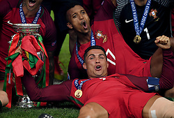 Cristiano Ronaldo of Portugal celebrates with the Henri Delaunay Trophy and Portugal team mates Winning the Uefa European Championship - Mandatory by-line: Joe Meredith/JMP - 10/07/2016 - FOOTBALL - Stade de France - Saint-Denis, France - Portugal v France - UEFA European Championship Final