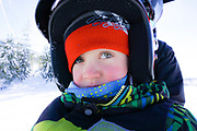 Little boy on snowmobile. Winter near McCall. MR