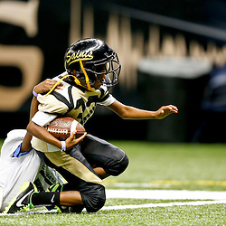 Aug 16, 2013; New Orleans, LA, USA; Youth football players compete as part of the NFL Heads Up program at halftime during of a preseason game between the New Orleans Saints and the Oakland Raiders at the Mercedes-Benz Superdome. Mandatory Credit: Derick E. Hingle-USA TODAY Sports