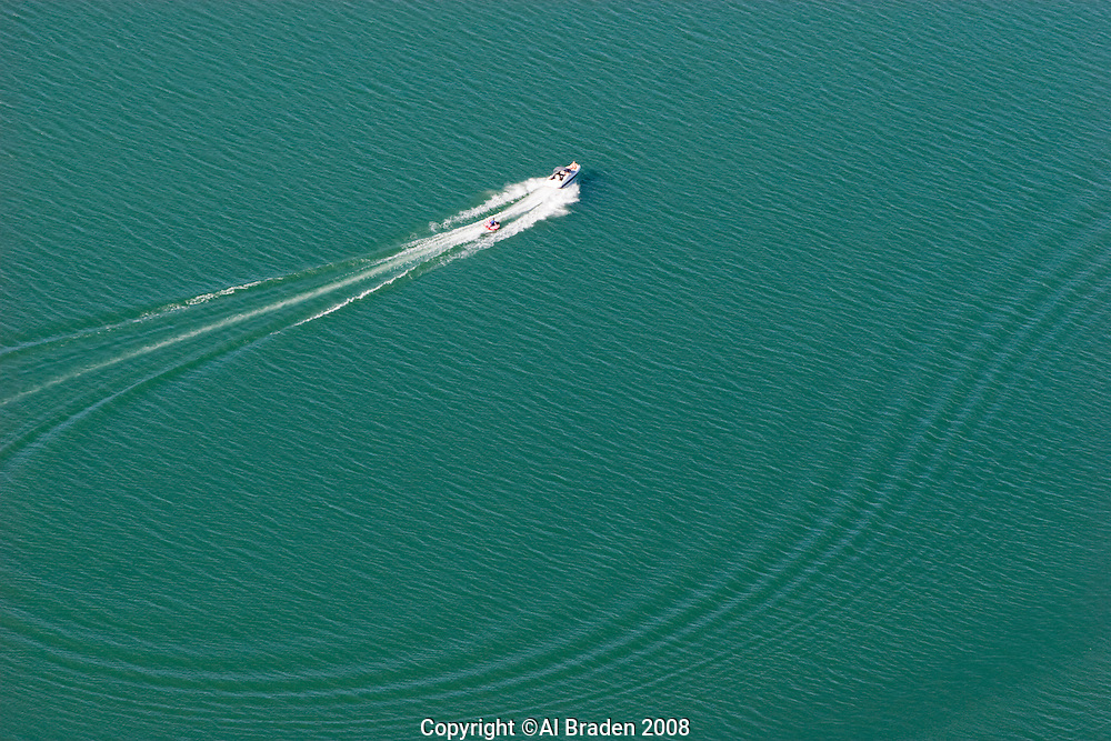 Aerial of boat on Lake Travis,  a favorite playground near Austin, Texas.
