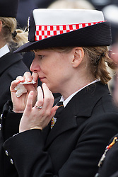 © Licensed to London News Pictures . 02/09/2013 . Bury , UK . A woman cries . Hundreds of fire service personnel in full dress uniform packed central Bury to listen to the service as it was relayed via loudspeaker from inside the church . The funeral of fireman Stephen Hunt at Bury Parish Church today (Tuesday 3rd September 2013) . Stephen Hunt died whilst tackling a blaze at Paul's Hair World in Manchester City Centre in July 2013 . Photo credit : Joel Goodman/LNP