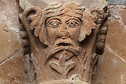 Carved capital with human head from the colonnade of the main building of the old cloister, built under abbot Begon III in 1097-1107, in the Abbatiale Sainte-Foy de Conques or Abbey-church of Saint-Foy, Conques, Aveyron, Midi-Pyrenees, France, a Romanesque abbey church begun 1050 under abbot Odolric to house the remains of St Foy, a 4th century female martyr. The church is on the pilgrimage route to Santiago da Compostela, and is listed as a historic monument and a UNESCO World Heritage Site. Picture by Manuel Cohen