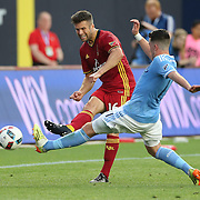 NEW YORK, NEW YORK - June 02: Chris Wingert #16 of Real Salt Lake passes the ball past Jack Harrison #11 of New York City FC in action during the NYCFC Vs Real Salt Lake regular season MLS game at Yankee Stadium on June 02, 2016 in New York City. (Photo by Tim Clayton/Corbis via Getty Images)