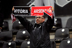 A fan shows their support in the stands with a Vitoria Guimaraes v Arsenal scarf