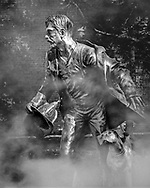 The statue in front of the Aurora Regional Fire Museum pays tribute to all fire fighers, past and present, who run selflessly toward danger whenever they are called upon.   Aspect Ratio 1w x 1.25h
