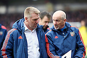 Brentford Head Coach Dean Smith in conversation during the Sky Bet Championship match between Brentford and Bristol City at Griffin Park, London, England on 16 April 2016. Photo by Matthew Redman.