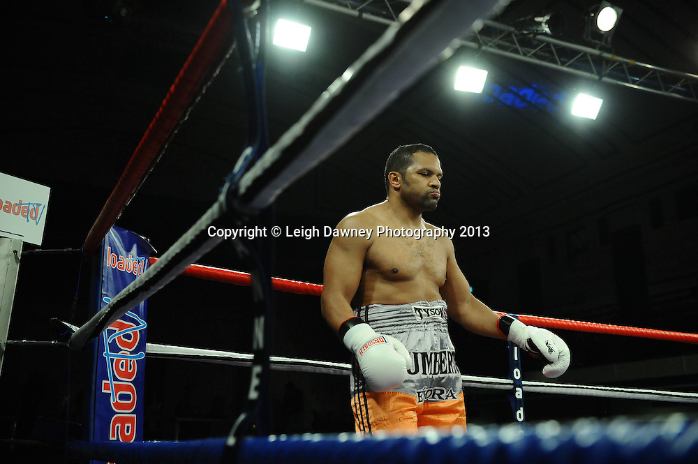 Gary Cornish (Scottish flag shorts) defeats Humberto Evora after he retired in a heavyweight contest at York Hall, Bethnal Green, London, UK on the 15th March 2013. Frank Maloney Promotions. © Leigh Dawney Photography 2013.