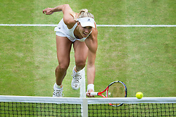 LONDON, ENGLAND - Saturday, July 9, 2016:  Angelique Kerber (GER) just pooping the ball over the net during the Ladies' Singles - Final match on day thirteen of the Wimbledon Lawn Tennis Championships at the All England Lawn Tennis and Croquet Club. (Pic by Kirsten Holst/Propaganda)