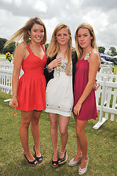 Left to right, COCO FRASER, EMERALD CLEVELEY and the HON.EMILY PEARSON at the 2009 Veuve Clicquot Gold Cup Polo final at Cowdray Park Polo Club, Midhurst, West Sussex on 19th July 2009.
