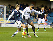 Bury forward Leon Clarke fish for the ball with Millwall midfielder George Saville during the Sky Bet League 1 match between Millwall and Bury at The Den, London, England on 28 November 2015. Photo by David Charbit.