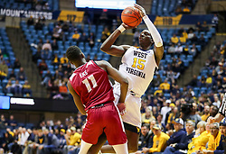 Nov 28, 2018; Morgantown, WV, USA; West Virginia Mountaineers forward Lamont West (15) draws a foul on a three pointer from Rider Broncs forward Devine Eke (11) during the second half at WVU Coliseum. Mandatory Credit: Ben Queen-USA TODAY Sports