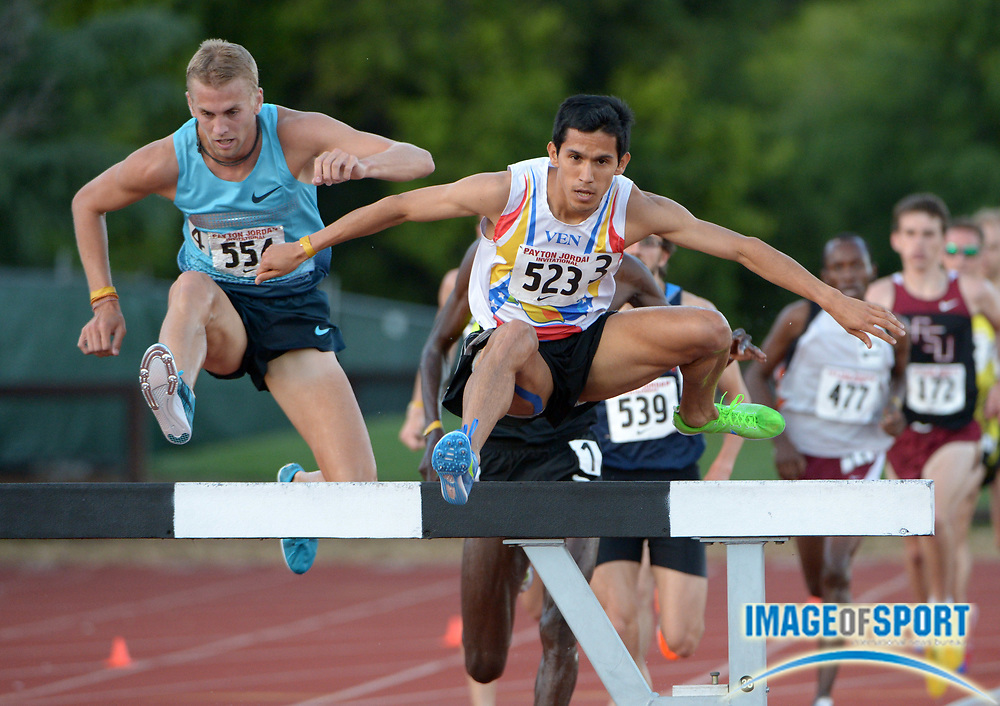 Apr 28, 2013; Stanford, CA, USA; Matt Hughes (CAN), left, defeats Jose Pena (VEN) to win the steeplechase, 8:21.34 to 8:22.56, in the 2013 Payton Jordan Invitational at Cobb Track & Angell Field.