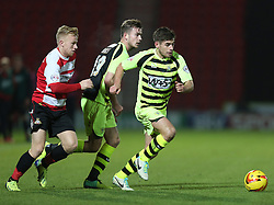 Yeovil Town's Joe Edwards gets away from Doncaster Rovers' Mark Duffy - Photo mandatory by-line: Matt Bunn/JMP - Tel: Mobile: 07966 386802 22/11/2013 - SPORT - Football - Doncaster - Keepmoat Stadium - Doncaster Rovers v Yeovil Town - Sky Bet Championship