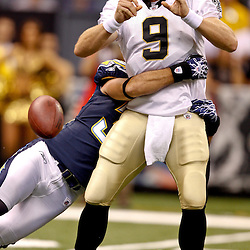 August 27, 2010; New Orleans, LA, USA; New Orleans Saints quarterback Drew Brees (9) has the ball stripped by San Diego Chargers safety Eric Weddle (32) during the first quarter of a preseason game at the Louisiana Superdome. Mandatory Credit: Derick E. Hingle