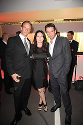 Left to right, RUPERT PENRY-JONES, DERVLA KIRWAN and JAMES PUREFOY at a party to celebrate 150 years of TAG Heuer held at the car park at Selfridge's, London on 15th September 2010.