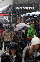 © under license to London News Pictures. 18/12/10.  As heavy snow hits central London shoppers brave the cold to buy last minute Christmas gifts in Oxford Street. Credit should read Matt Cetti-Roberts/London News Pictures