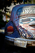 "SHOT 1/18/10 11:30:24 AM - A broken down Volkswagen Beetle in the streets of Sayulita, Mexico. More than 21 million Volkswagen Beetles were built and sold in Mexico with the last one rolling off the production lines in 2003. Many other makes and models of vehicles have since replaced what was the most popular car in Mexico for a long time. Sayulita is a small fishing village about 25 miles north of downtown Puerto Vallarta in the state of Nayarit, Mexico, with a population of approximately 4,000. Known for its consistent river mouth surf break, roving surfers ""discovered"" Sayulita in the late 60's with the construction of Mexican Highway 200. In recent years, it has become increasingly popular as a holiday and vacation destination, especially with surfing enthusiasts and American and Canadian tourists. (Photo by Marc Piscotty / © 2009)"