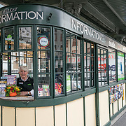 Visit Seattle Pike Place Market Information Booth Concierge Lee. Photo by Alabastro Photography.