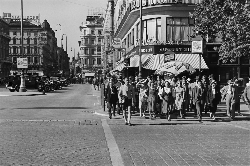 St. Charles Church, crowd crossing Kärntnerstrasse, Vienna, Austria, 1938