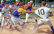 KRAIN photo, 5/16/97<br /> Mountain Home's David Drewry grabs Sheridan's Cliff Crouse during a fight after the AAAA title baseball game Friday. Mountain Home won the game 6-5.