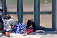 Roma 12 maggio 2015<br /> Il giorno dopo lo sgombero  dell'insediamento  nei pressi della stazione della metropolitana di Ponte Mammolo, abitato da circa 400 migranti, per lo più richiedenti asilo e rifugiati di Eritrea e di alcune famiglie ucraine, circa 250 persone  rimaste senza casa vivono nel parcheggio vicino alle case distrutte senza nessuna assistenza dalle istituzioni.<br /> Roma, Italy. 12th May 2015 <br /> The day after the evacuation of the settlement near the Ponte Mammolo metro station,inhabited by about 400 migrants, most asylum seekers and refugees to Eritrea and some Ukrainian families, about 250 people left homeless are living in the parking lot near the destroyed homes without any assistance from the institutions.