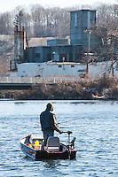 A fisherman heads into the Winnipesaukee River from Lake Winnisquam on opening day for landlocked fishing season Wednesday morning.  (Karen Bobotas/for the Laconia Daily Sun)