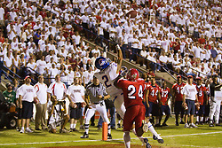 Sep. 18, 2009; Fresno, CA, USA;  Boise State Broncos wide receiver Austin Pettis (2) leaps for a touchdown catch past Fresno State Bulldogs cornerback Desia Dunn (24) during the fourth quarter at Bulldog Stadium. Boise State defeated Fresno State 51-34.