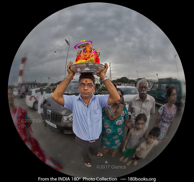 A Family in Chennai Taking a Ganesha Statue to the Beach.
